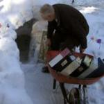 David Marusek wheeling books into snow cave