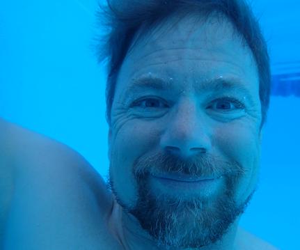 Author Ned Rozell underwater